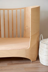 Detail of fitted cot sheet in Hazelnut