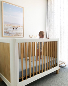 Fitted cot sheet in blue as seen in @dotandpop boy's nursery