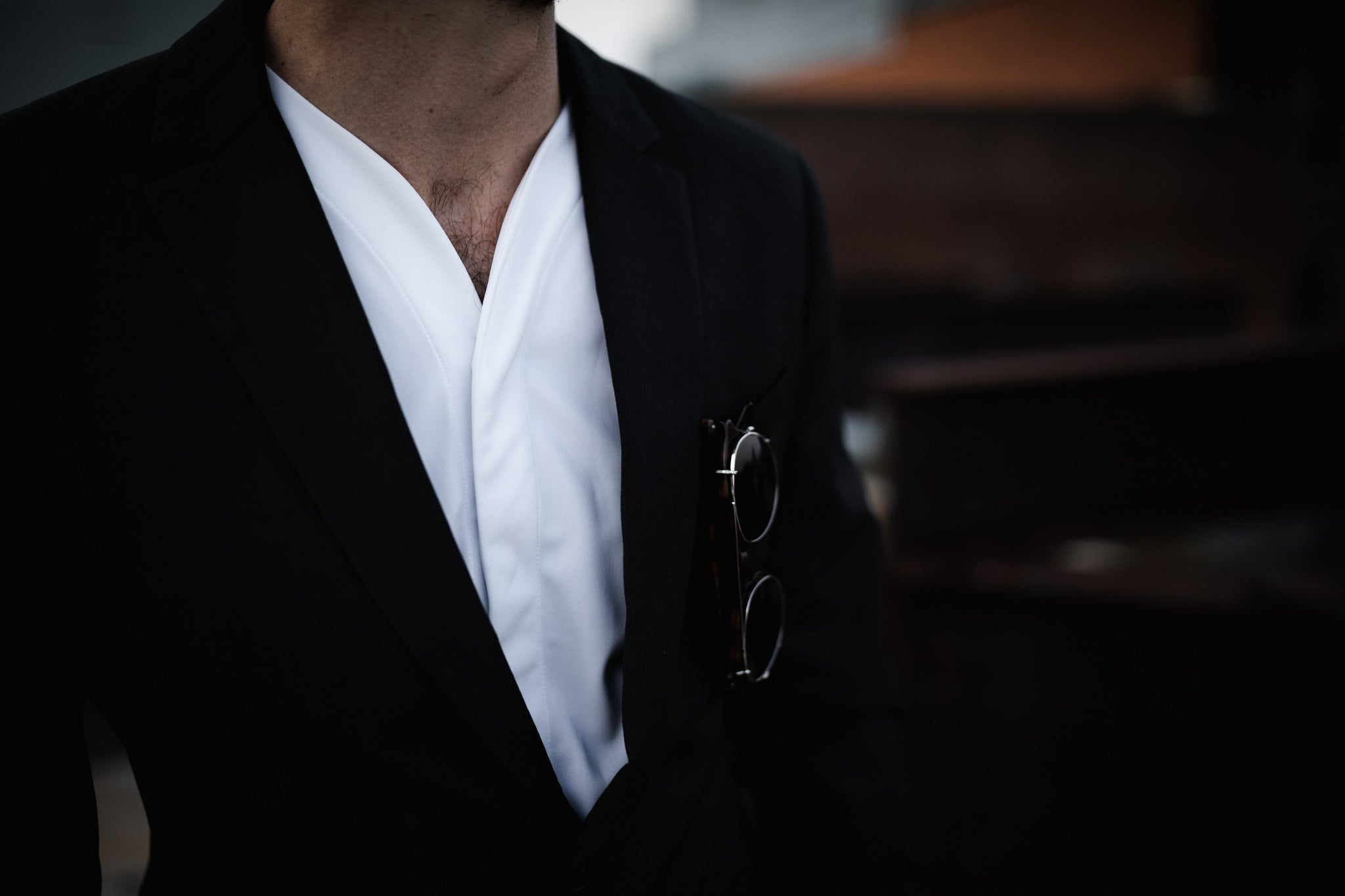 collarless shirt worn with a suit
