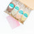 Joy Pop ice pops in milk and cookies strawberry shortcake fudgsicle and orange cream in a box with a joy pop card on a white background