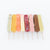 8 joy pop ice pops laying side by side next to each other on a white background
