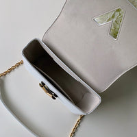LOUIS VUITTON® Special Twist Handbag