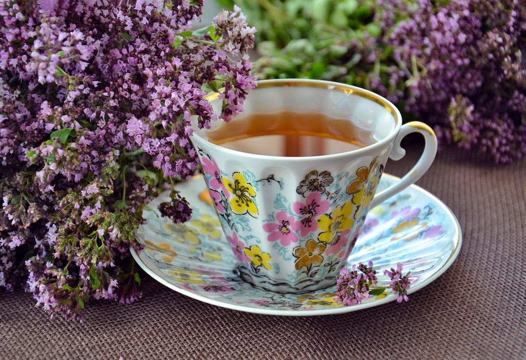 painted tea cup with lilacs