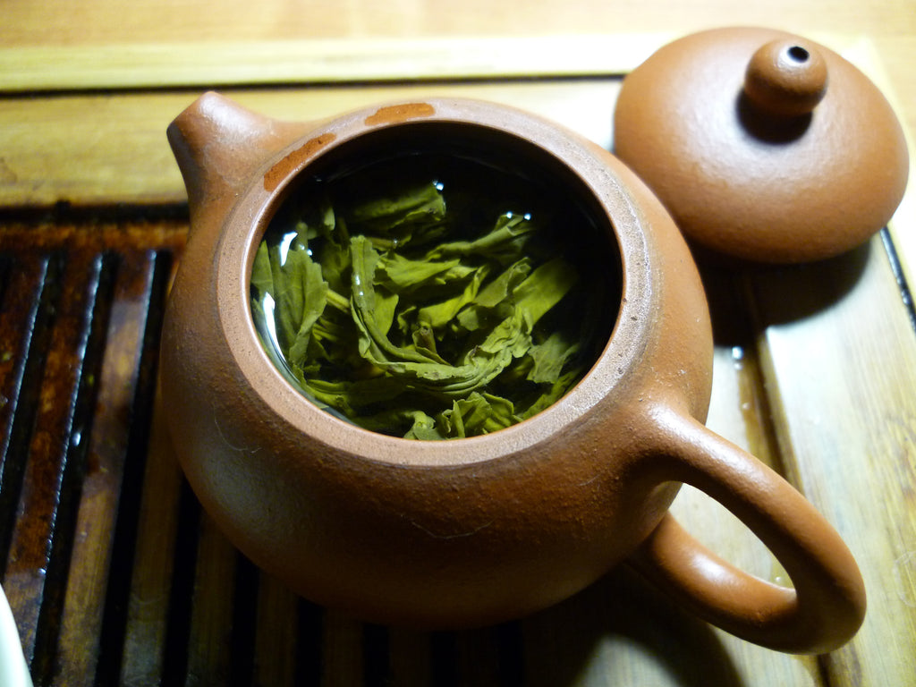 harbin pot with green tea leaves