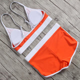 Designer summer garment in orange and whote