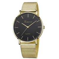 Gold tone quartz watch with black dial