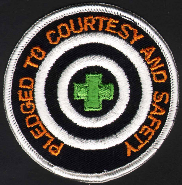 Vintage uniform patch PLEDGED TO COURTESY with green cross unused new old stock