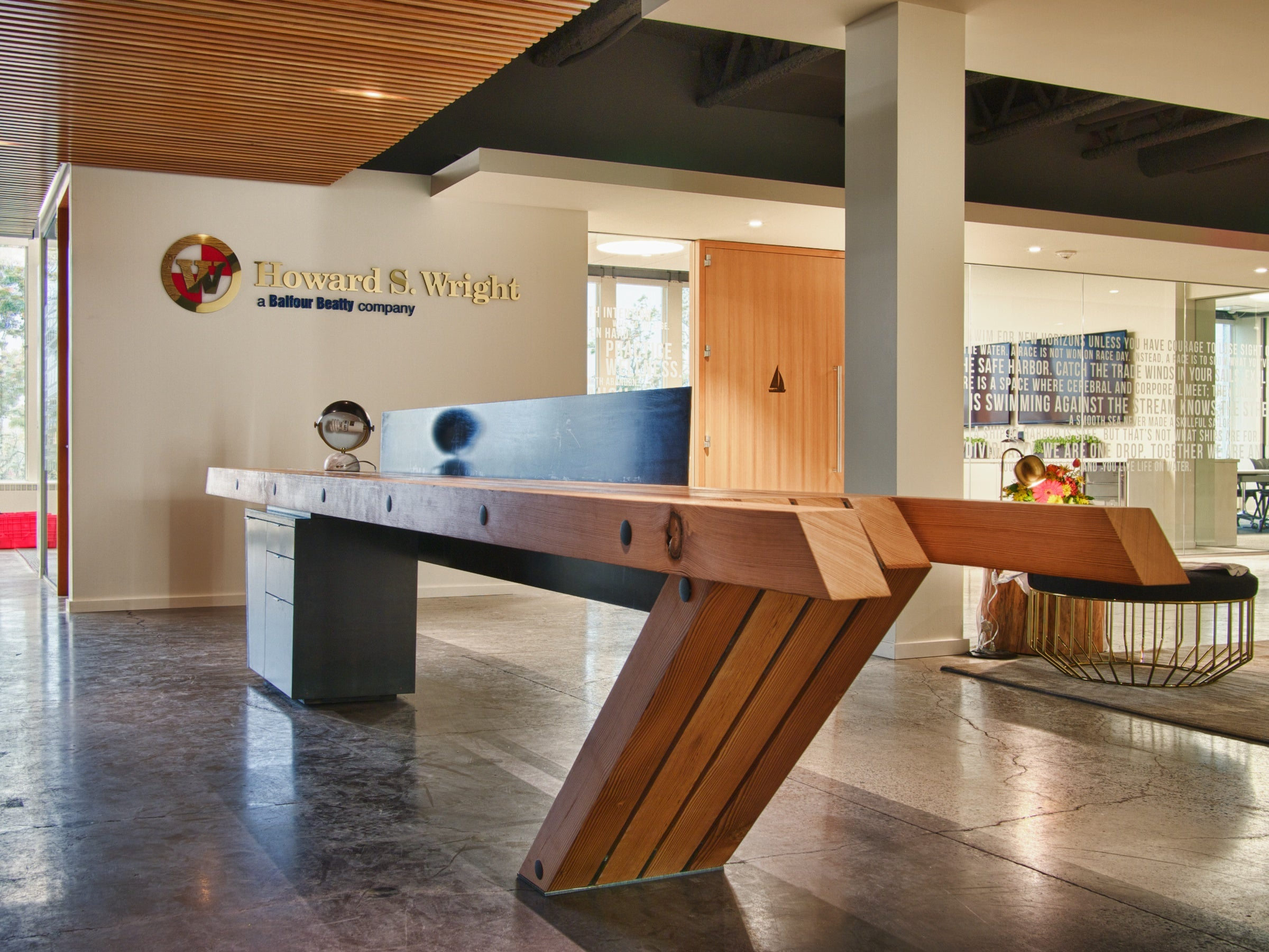Reclaimed Douglas Fir & metal reception desk | Howard S. Wright, Seattle, WA