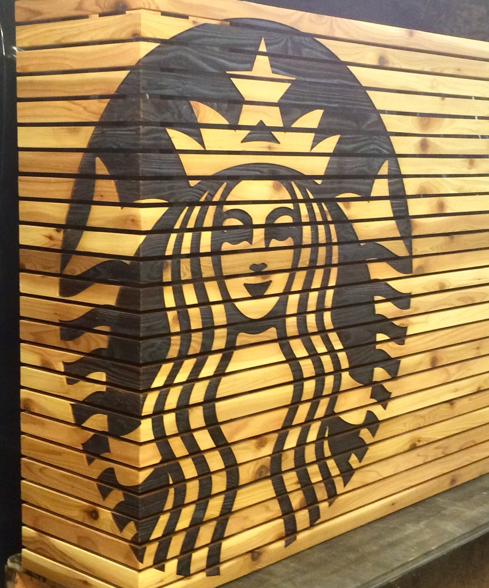 Engraved logo on panelized Alder | Starbucks, Santa Monica CA