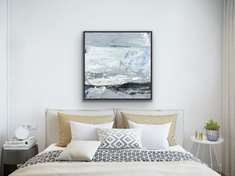 Canvas print wall art of modern abstract painting by Julia Contacessi featuring sweeping, gestural paint marks in a light coastal palette, accents of metallic silver splatters, and grounded in a wash of black.