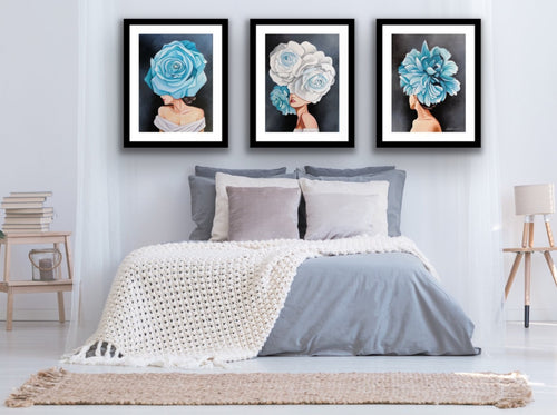 Set of 3 elegant woman wearing a blue and white floral fascinator headpiece by Julio Garcia. Artwork printed on archival art paper and framed with 2 inch black frame, 3 inch white mat border, and plexi glass covering.