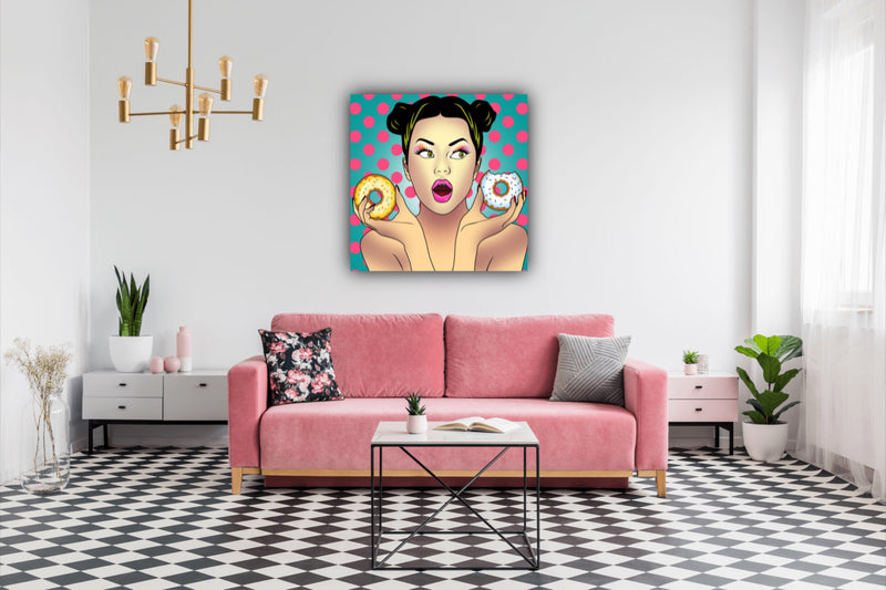 Canvas print wall art of comic pop art of girl holding donuts.
