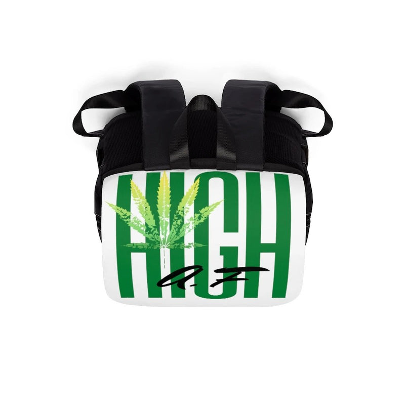 A black backpack with white flap with the text high af in green and a lighter green marijuana leaf