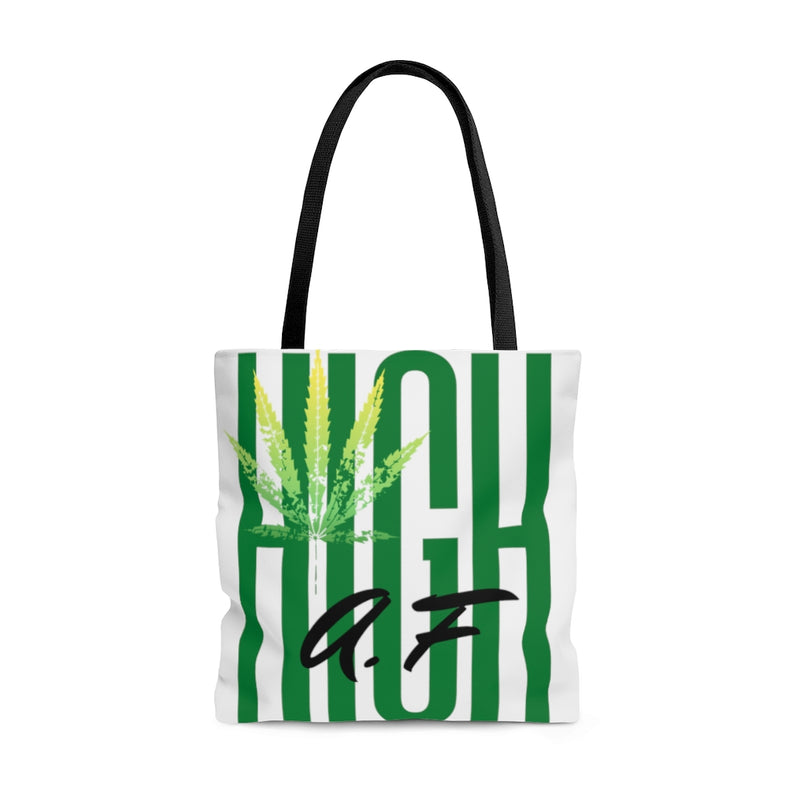 A white tote bag with green text high af