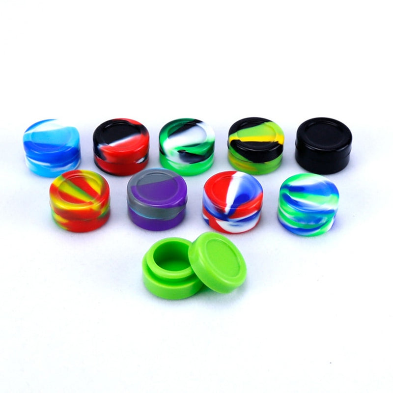 A variety of colors of silicone containers for dab wax