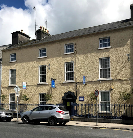Photo of 3 storey yellow building - ProActive Physio clinic at Gort Medical Centre