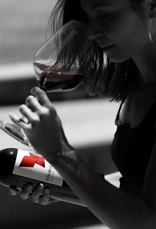 a woman smelling a glass of 2018 cabernet sauvignon by Double Diamond Wines