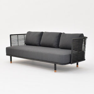 cane wood sofa black with gray cushions