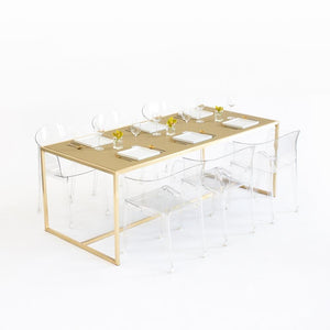 Maxwell Dining table with Gold Chilewich insert & clear chairs
