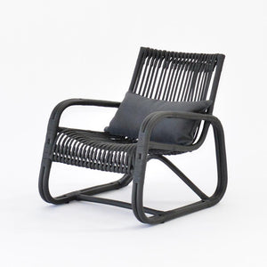 curve lounge chair in black cane wood with cushion
