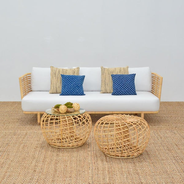 cane side tables with cane sofa