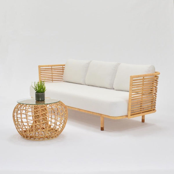 cane sofa natural with white upholstery and side