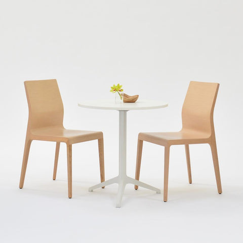 cafe table with blonde chairs