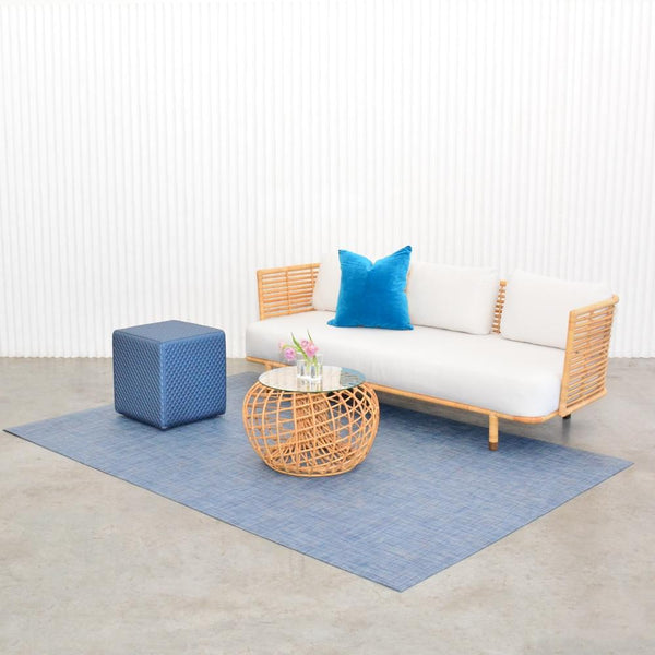 chilewich denim floor mat with cane sofa