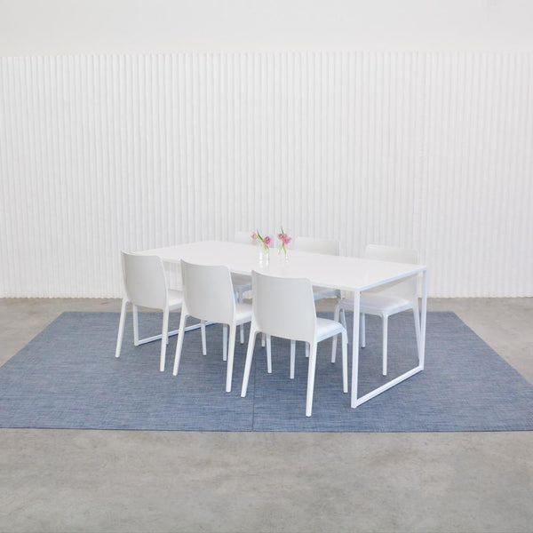 chilewich denim floor mat with white table and chairs
