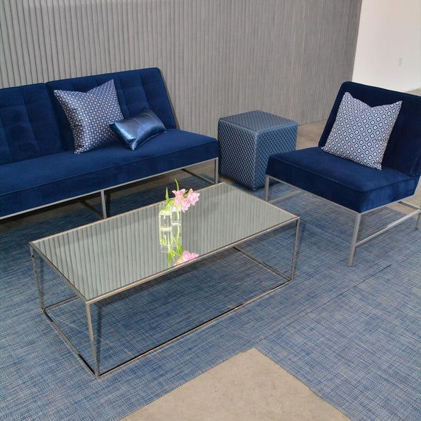 close up of chilewich denim floor mat with aston blue seating