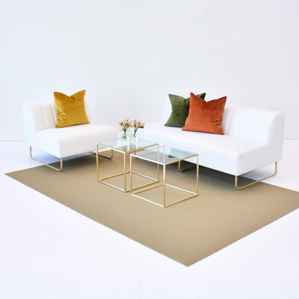 lounge set up of chilewich new gold floor mat