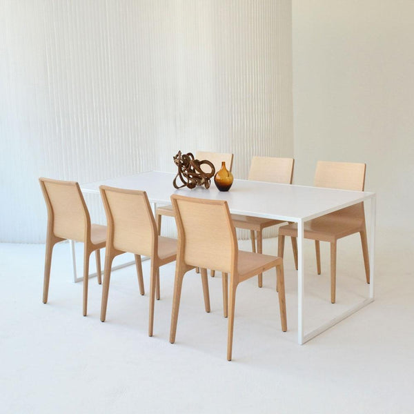 pawson table with blonde chairs