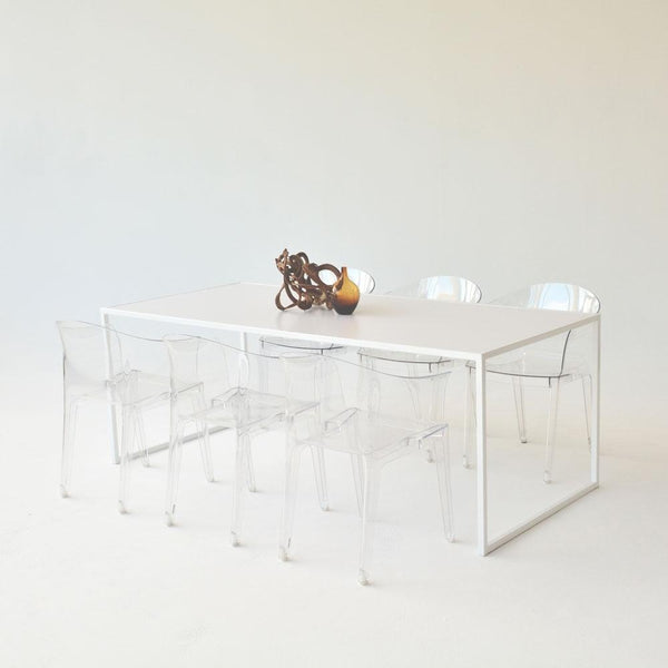 pawson table with clear chairs
