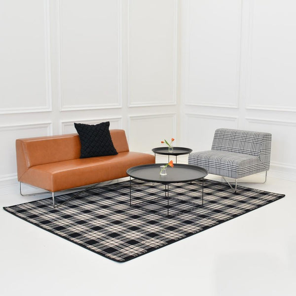 st andrews plaid rug with balance saddle sofa and plaid chair