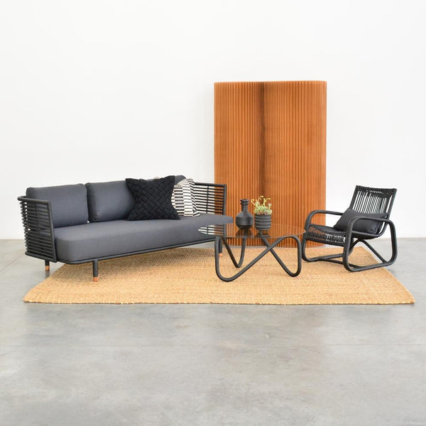 wave coffee table black with cane sofa, curve chair
