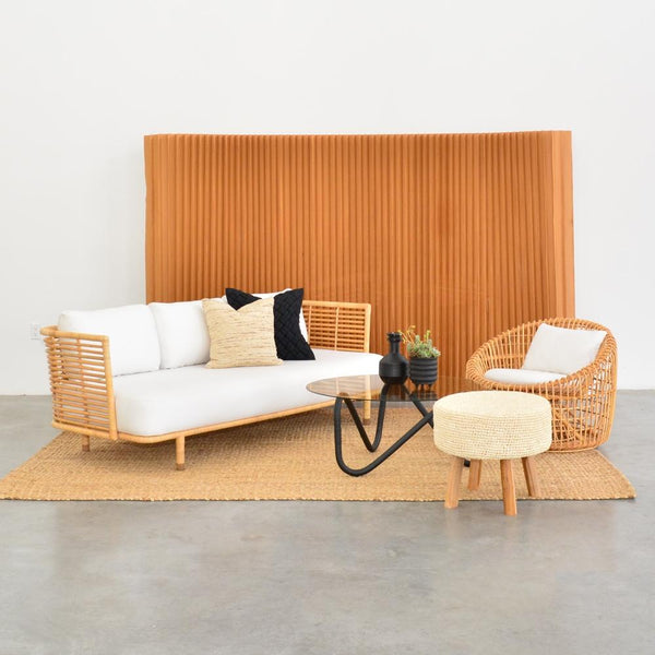 wave coffee table black with natural cane sofa, chair