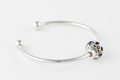 Warrior bead on silver bangle bracelet