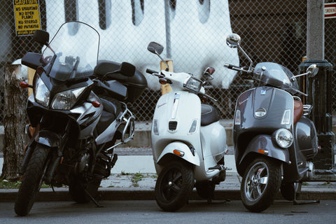 image showing 3 scooters representing an automobile shop