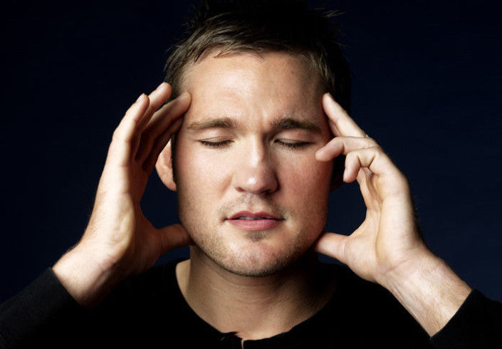 Man suffering from tinnitus with hearing loss