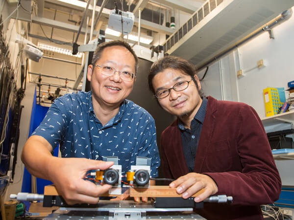 Professor Richard So and Calvin Zhang showcasing a prototype