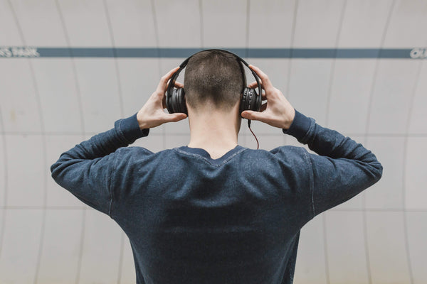 Man listening to music and possibly damaging his hearing