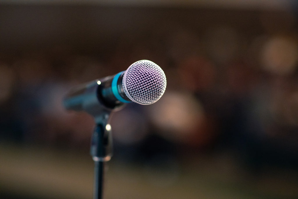 microphone whistling used to illustrate why hearing aids whistle and how to stop it