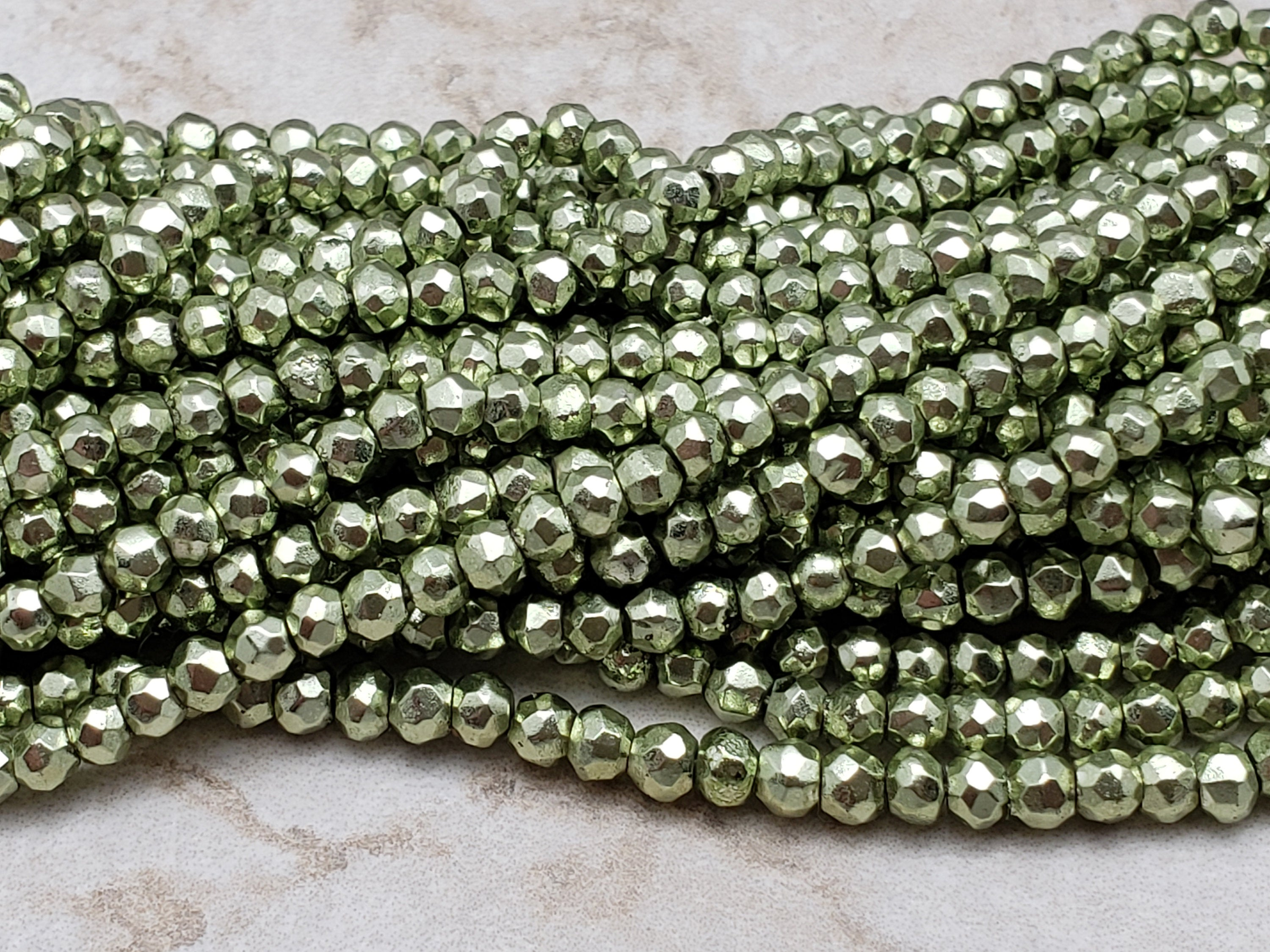 3.5mm to 4mm Lime Green Pyrite Faceted Rondelles, 13 inch