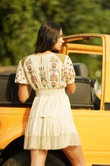 Tiered smocked embroidered mini dress