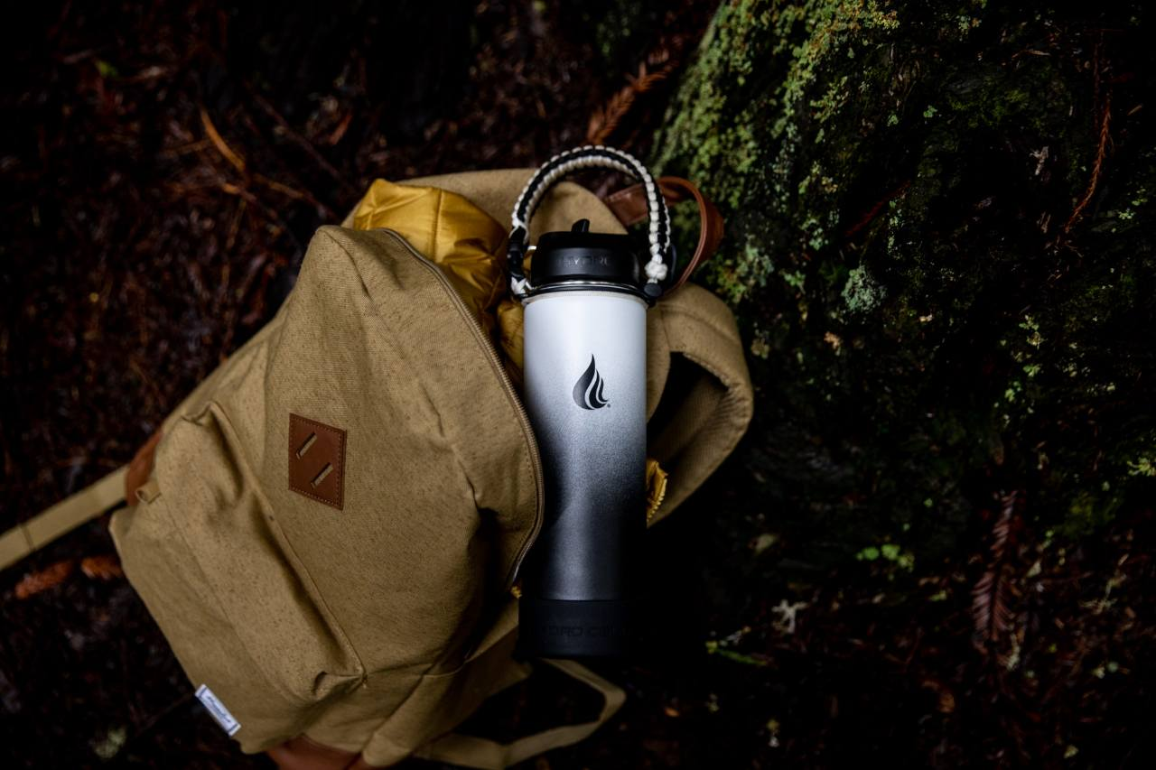 A Hydro Cell water bottle inside a brown backpack