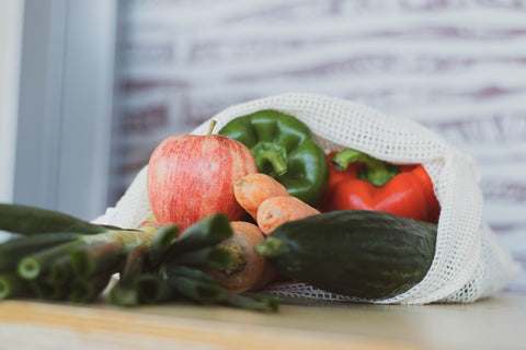 A bag of freshly sourced local produce including vegetables and fruits