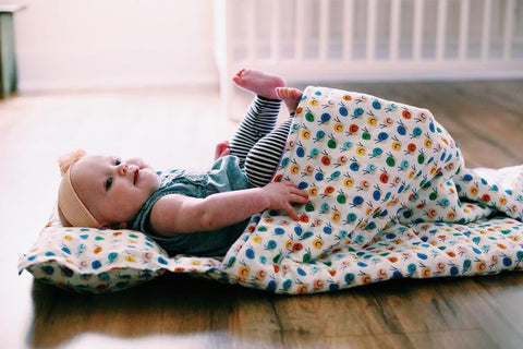 baby on nap mat