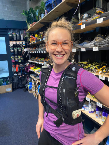 becky in the shop with her running pack