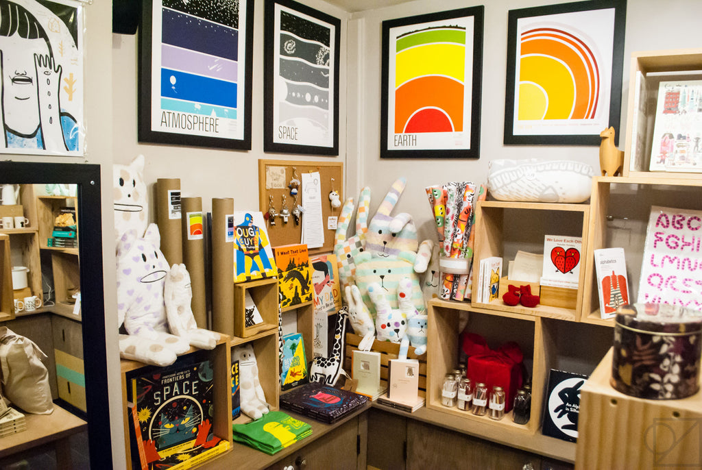 A wide shot look at our back room selection of prints, books, and accessories for children and adults alike
