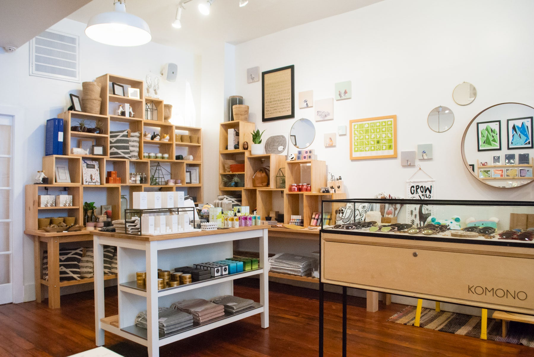 Personal accessories, home goods, and plant-based apothecary selects gather towards the back of the shop